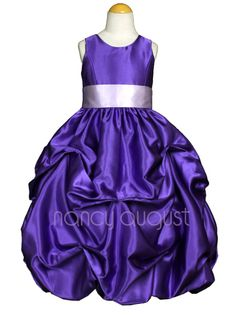 Purple Satin Pick-up Flower Girl Dress: This purple satin pick-up flower girl dress is rich in style. This sensational shiny jewel toned purple satin flower girl dress is made of poly satin that is soft to the touch. Simple and elegant with its removable sash waistband and modern pick-up bubble skirt with crinoline enhancement. Best of all you can pick your own customized sash color to match all your bridesmaid dresses!