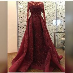 This pretty burgundy red long sleeve ball gown would be great for the mother's of the wedding. We make custom #eveningdresses for all sizes. You can also get #replicadresses made for less with us. Get pricing on any design at www.dariuscordell.com