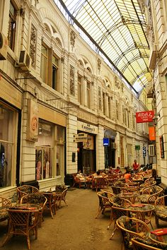 Coffee shops in the Villacrosse Passage, Bucharest, Romania- historical part of the city -architecture preserved from the time when the city had the nickname Little Paris (Le Petit Paris) -see also: http://www.pinterest.com/trandafirash/little-paris/
