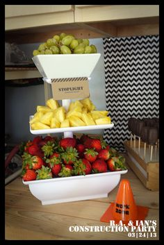 """Fruit """"stoplight"""" - green grapes, yellow pineapple, red strawberries"""