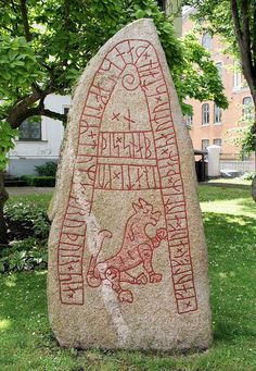 "The inscription reads: ""Káluf and Autir set this stone in memory of Tumi, their brother, who owned Guðissnapi""."