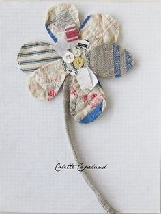 Made with part of a very old, faded quilt, and vintage and new fabrics. It is mean to hang on a wall, but can also be pinned anywhere. Ill be