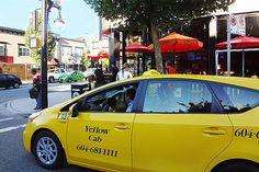 Yellow Cab dropping off a passenger at Caffe Roma on Commercial Drive at Grant