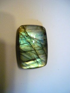 Labradorite...great for throat chakra...helps heal and seal aura, synchronicity and coincidence, developing intuition