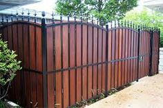 Wood and wrought iron fence