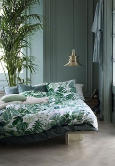 Botanical bedroom in beautiful green colours with patterned bedding.