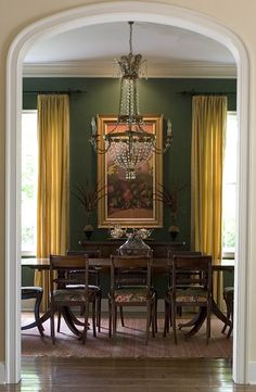 Formal dining room with warm tones and gorgeous entry