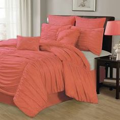 "Comforter set in coral with ruched detailing and matching accent pillows.  Product: Queen: 1 Comforter, 2 euro shams, 2 standard shams, 2 decorative pillows and 1 bedskirtKing: 1 Comforter, 2 euro shams, 2 king shams, 2 decorative pillows and 1 bedskirtConstruction Material: MicrofiberColor: CoralFeatures: Accent pillow inserts includedDimensions:  Euro Sham: 26"" x 26"" each Standard Sham: 20"" x 26"" each King Sham: 20"" x 36"" each Small Decorative Pillow: 12"" x 12"" Large Decorative Pillow: …"