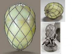 Diamond Trellis Egg 1892 Made of jade, gold, silver and diamonds, originally contained in the satin lined interior was the surprise of a gold clockwork elephant and its key. This is now missing. There was also meant to be a base with three cherubs representing the Tsarina's three children.