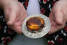 Hidden treasure: Balmoral's housekeeper  holds a Cairngorm Stone broach belonging to Princ...