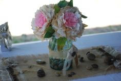 handmade coffee filter peoney 3 in a group mason jar decorated for family reunion rock on a handmade homemade fower burlap mat