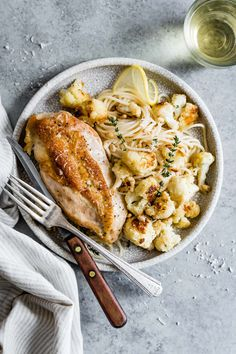 This chicken sheet pan dinner recipe is an easy way to get dinner on the table without much fuss. Lemon parmesan roasted cauliflower and crispy chicken breast tastes great on its own or served over buttered pasta! Parmesan Roasted Cauliflower, Clean Eating Dinner, Breakfast For Dinner, Dinner Meal, Fall Dinner, Seafood Dinner, What To Cook, Meal Planning, Main Dishes