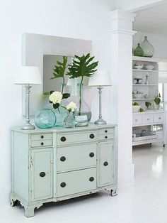BHG Cottage in the Minimalist White soft blue sideboard + blue glass vases