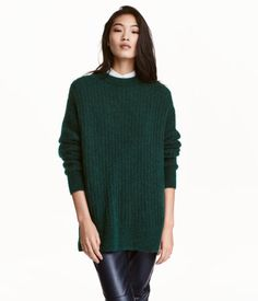 Dark green melange. Oversized rib-knit sweater in a melange wool blend with mohair content. Round neck, dropped shoulders, and long sleeves. Slightly longer