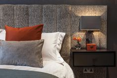Large padded headboard incorporating side table, bedside light and powerpoint below light.
