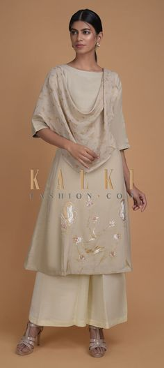 Buy Online from the link below. We ship worldwide (Free Shipping over US$100)  Click Anywhere to Tag Sand Beige Tunic In Cotton Enhanced With Foil Printed Floral Pattern And Attached Drape Online - Kalki Fashion Sand beige tunic in cotton enhanced with foil printed floral pattern on the hemline.Designed with an attached drape in linen on the shoulder with foil printed buttis in bird motifs and tassel on the edge