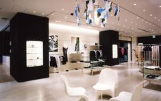 We are a global and creative design studio in Geneva, Tokyo and Beijing. Japan Interior, Black Coats, Shelf Paper, Travel Store, Paper Lampshade, Interior Architecture, Interior Design, Aesthetic Design, Corian