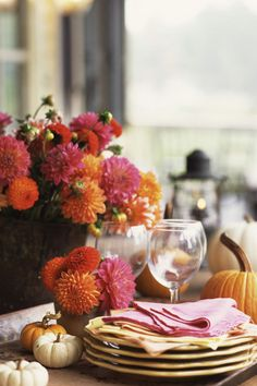 Vibrant Chrysanthemums: Mums are basically fall's version of peonies, and with so many colors, what's not to love? The blooms also symbolize optimism, joy and longevity — just what your Thanksgiving table needs. Click through for more fall flower arrangements and centerpieces you'll love!