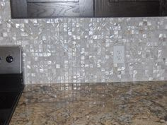 love this mother of pearl backsplash.