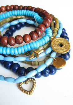 Such an understatedly beautiful stack of wood, glass and bone beaded bracelets. #bracelet #wood #zen #serenity #meditation #earthy #boho #metal #wood #beads #accessories