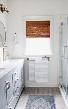 Spring 2018: A Wannabe Minimalist Home Tour master bathroom - Simple Stylings - www.simplestylings.com - home decor - white walls - minimal - modern bathroom - shiplap - subway tile
