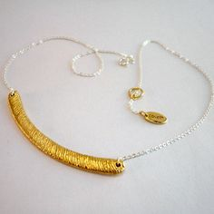 Sterling silver necklace with 22ct gold-plated textured bar. Necklace is designed to be worn short and layered with other pieces and is 41cm in length.