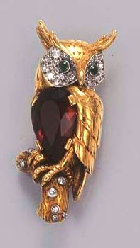 A GEM-SET OWL BROOCH, BY CARTIER  The owl with pear-shaped citrine body, pavé-set diamond and emerald eyes perched on a diamond-set branch, circa 1955, 4.4 cm. high Signed Cartier London