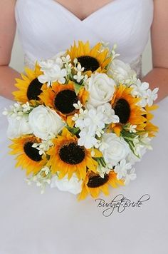 Sunflower wedding flower brides bouquet with sunflowers, white roses and white filler. Perfect for a. , sunflower wedding Sunflower wedding flower brides bouquet with sunflowers, white roses and white filler. White Rose Bouquet, White Roses Wedding, Fall Wedding Flowers, Bridal Flowers, Flower Bouquet Wedding, Rose Wedding, Rustic Wedding Bouquets, Dream Wedding, Sunflower Wedding Decorations