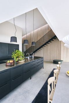 Built for a family, who are the third generation owners of VIPP this beach villa, Dragor House, is designed by Studio David Thulstrup and Mads Lund. Home Decor Kitchen, Kitchen Interior, Kitchen Design, Kitchen Ideas, Buy Kitchen, Kitchen Tools, Black Kitchen Island, Beach Villa, Beach House