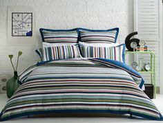 A fresh take on traditional quilting, the Murphy quilt cover is a contemporary design with universal appeal. In a tonal palette of blue and green, this relaxed, stripe design is finished with a plain blue reverse and tailored edge. Navy Bedding, Bath Table, Single Quilt, Striped Quilt, Murphy Bed Plans, Queen Quilt, Decorate Your Room, Quilt Cover, Bed & Bath
