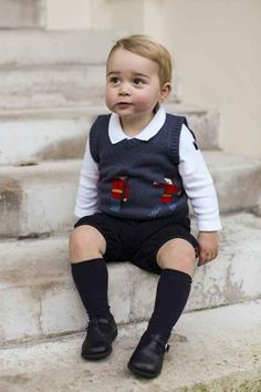 Prince George's New Portraits Are Royally Adorable - just look at his little sweater vest! It features the iconic Queen's Guard, who protect Buckingham Palace.