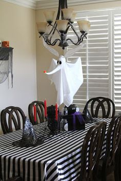 I finally got my pictures uploaded of my daughter's Nightmare Before Christmas party decor and thought I would share ...