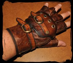 steampunk leather glove by Lagueuse on DeviantArt Steampunk Gloves, Steampunk Costume, Steampunk Diy, Leather Armor, Leather Gloves, Neo Victorian, Renaissance Fair, Dieselpunk, Military Fashion