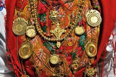 Gold necklace and traditional costume (Lavradeira) of Minho. Our Lady of Agony Festivities, the biggest traditional festival in Portugal. Vi...