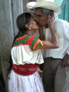 • older couple kissing, Mexico or Guatemala