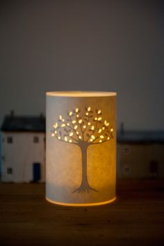 Tree of Life Candle Cover  by designer/maker                   – Hannah Nunn. It's made of glowing liminated parchment and comes with a glass jar inside to protect the shade from the tea light candle. can be bought on my website www.hannahnunn.co.uk and shipped all round the world   #candlecover #tealightcover #treeoflife #inspiredbynature ##paperlantern #paperlampshade #hannahnunn #handmade