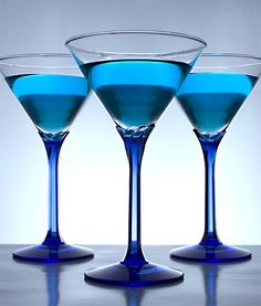 blue martini | 3 oz. gin 1 1/2  oz. blue curacao | in a shaker half filled with mini ice cubes add gin and blue curacao. let rest for five minutes then shake vigorously. strain into 9 oz classic martini glass. garnish with a lemon wheel.