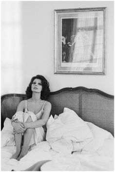 Sophia Loren sitting in an unmade bed Photo Terry O'Neill 1965
