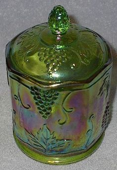Adopt from Fathertime: Grape design green iridescent Carnival Glass canister jar is 7 inches tall at top of cover. The jar is 4 inches across. The design shows grapes and leaves Condition: Vintage Used Defects: None I see Comment: Very Nice,. Fenton Glassware, Antique Glassware, Cut Glass, Glass Art, Antique Dishes, Glass Canisters, Green Home Decor, Glass Dishes, Dinner Ware