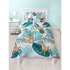 The reversible duvet cover features Bambi, Thumper and colourful palm leaves on a white background, with a smaller repeat pattern on the reverse. Free UK delivery available