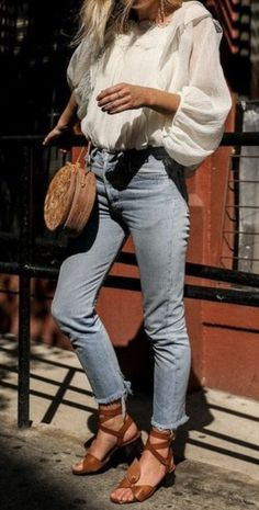 bell sleeve top + levis jeans + urban outfitters circle straw bag + lace up sandals | womens everyday style and outfits