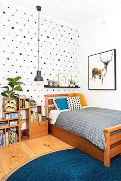Cute bedroom with warm wood tones, rustic vibe and teal. Love the deer art.
