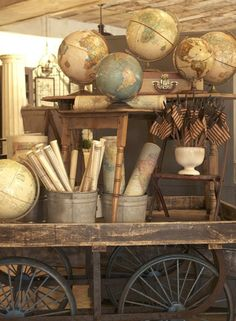Vintage Maps, Globes and Flags - cute idea to roll up the maps in buckets.