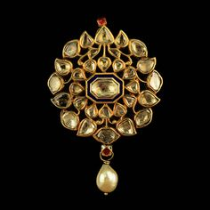 A Diamond and Pearl Pendant with Enamel Back   India  18th c.  Diamond, Pearls and Enamel  Length 5cm