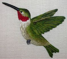 When embroidered in silk - thread painting is also known as silk shading. This exquisite hummingbird was designed and embroidered by Kelley Aldridge when she was a student at the Royal School of Needlework.  You can see more of Kelley's work on her Facebook page at Love Stitch at https://www.facebook.com/lovestitchbristol/timeline  And on her website at http://www.lovestitch.org.uk/