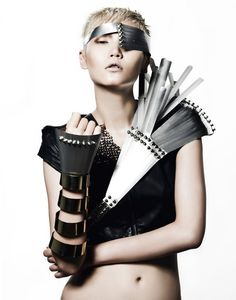 Gwen Lu - Model Gwen Lu looks like she's ready to take on the big guys in this shoot. Sporting futuristic gear as accessories, this shoot represents the toug. Mad Max Fashion, Fashion Art, Pirate Hair, Grandeur Nature, Pirate Fashion, Pirate Woman, Body Adornment, Body Armor, Future Fashion