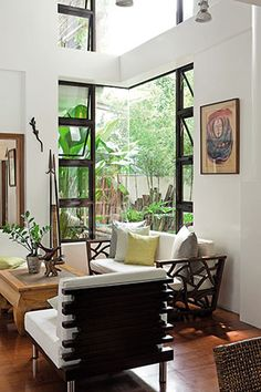 Recycled wood completes a Modern Tropical House in Quezon City Real Living Philippines ideas philippines Build Your Cozy, Earth-Friendly Home Using Recycled Wood Modern Tropical House, Tropical House Design, Tropical Interior, Tropical Houses, Tropical Living Rooms, Tropical Windows, Tropical Furniture, Living Furniture, Home Furniture