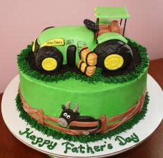 John Deere cake with tractor made of Rice Krispie Treats and fondant