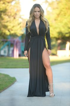- Deep V Neckline - Padded Shoulders - Maxi Length - Double Slit - Long Sleeve - Made in USA - 95% Polyester 5% Spandex
