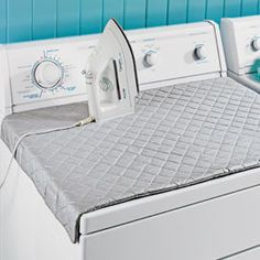 This makes way more sense than dragging an ironing board out:    Quilted ironing board with magnets for the top of the dryer!